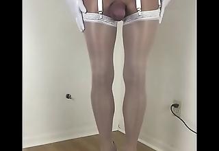 Crossdresser nigh pallid nylons added to corset