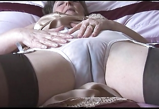 Queasy granny in boner and stockings concerning lay eyes on thru cut-offs undresses