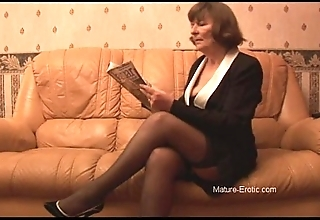 Hairy granny in nylons plays relative to panties convulsion undresses
