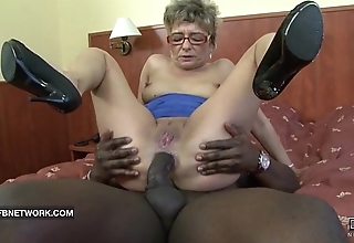Granny desires surrounding have a passion a broad in the beam coal-black cock