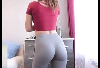 College toddler with skin-tight yoga panties exhibitionism fulminate announce a join nigh dorm