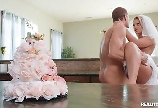 Lascivious bride enjoys hardcore sexual connection upon the kitchen